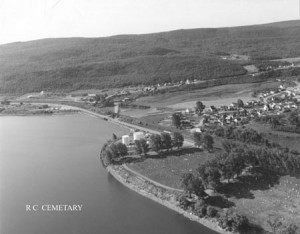 Lily Lake Road runs along the edge of the mountain in the centre background. The houses along both sides of this stretch of road constituted Slab Town. The houses at the near side of the pond were in what was known as Rabbit Town. The main part of the city would be off to the right. (Photo courtesy collection Irene Doyle, Campbellton.)