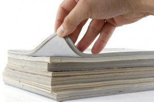 hand-browsing-through-paper